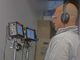 st louis video producer watches the video and listens to the audio being captured on a recent location production.