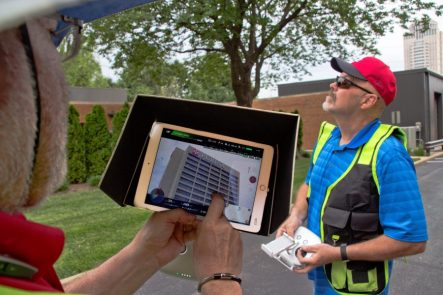 Close up of drone navigator camera screen and pilot.